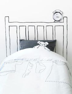 Cool idea! Paint a head board and then mount things to the wall to make it look like its resting on the headboard.