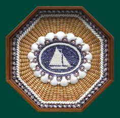Beautiful shell art.  I would love this with an anchor in the center.  Rowayton, Anne Jayson