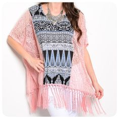 Crochet Fringe Top - Fits like free-size Gorgeous pink crochet fringe top w/ black, white & blue designed panel on front & back. Layer it over a cami of your choice, or over you bikini! Very versatile & can be worn year round! 95% Rayon, 5% Spandex. These are like a free size & are supposed to be worn big. Sizes are: S (will fit S to L), M (will fit L to XL). This top is high quality & is stunning. I have received many compliments on mine! Tops Tunics