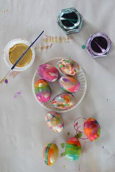 Children paint gorgeous wooden eggs for Easter.