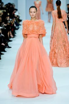 Elie Saab.......candyfloss vision of femininity wafted onto the couture  catwalk Wednesday afternoon in a profusion of bows, crystals and pastel  hues