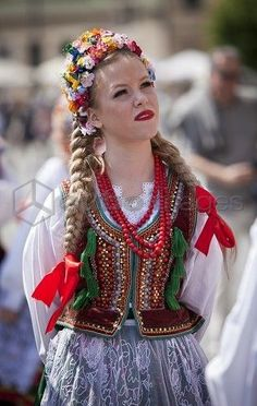 Poland, Cracow. Polish girl in traditional dress preparing to dance in Market Square, | http://aodai62.blogspot.com