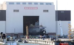 HMS Audacious is taken out of it's indoor ship building complex at BAE Systems, Burrow-in-Furness, and placed on the water for the first time in a huge milestone