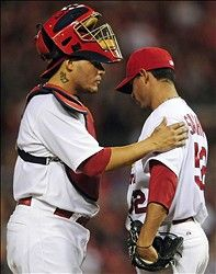 Yadier Molina  talks with relief pitcher Eduardo Sanchez during the game 6-14-12