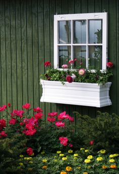 Another idea for the fence...Hang an old window...like the planter box too :)
