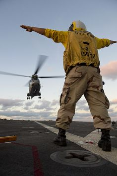 ♂ helicopter as it prepares to land on the flight deck of the amphibious dock landing ship USS Pearl Harbor by U.S. Pacific Fleet