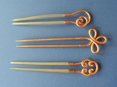 These three hairpins have coiled rolled-gold headings with attached tines of blonde tortoiseshell (2) and brass (1). British 1870-90. Between 4 & 5 inches (10 –12.5 cm) in length.