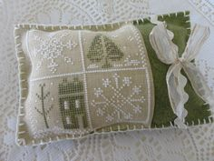 Little House Needleworks design from Just Cross Stitch ornament issue 2011. Very pretty finish with felt and trims.