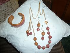 Necklace, bracelet, and earrings. Made by 'Gilly' and created by Jeanne McCombs Rushton