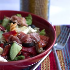This recipe for Antipasto Pasta Salad is an Italian inspired salad that makes a fresh and vibrant addition to any picnic or barbecue.