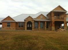 Beautiful Texas Hill Country style home with stone and hardie with cedar shutters and accents by Kurk Homes