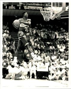 Dominique Wilkins going in for the windmill dunk! Love the retro look back then.