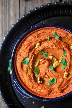 Muhammara Recipe (Roasted Red Pepper Dip) | The Mediterranean Dish. A hearty vegan dip with roasted red peppers and walnuts with a splash of pomegranate molasses and Mediterranean spices. See the step-by-step tutorial on TheMediterraneanDish.com