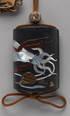 Case (Inrō) with Design of Squid, Shells and Seaweed - Hara Yōyūsai (Japanese, 1772–1845), Period: Edo period (1615–1868), early 19th century - Medium: Case: powdered gold (maki-e) and colored lacquer on black lacquer with mother-of-pearl and gold inlays; Fastener (ojime): ivory carved with abstract design;