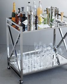 Bar carts have become home-design staples—thanks, Don Draper! But they also make fun vehicles for drinks and snacks at your reception.