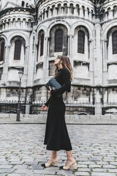 How to wear a backless black dress in a chic way.