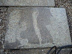 This shows how much dirt a pressure washer can remove from concrete slabs.