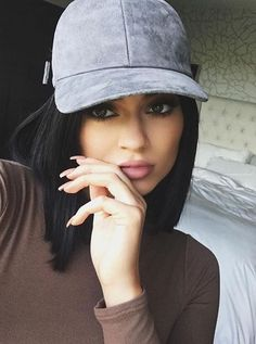 Kylie Jenner wearing Vianel Suede Baseball Cap in Charcoal and Naked  Wardrobe Bodysuit in Mocha 1d550931fa76