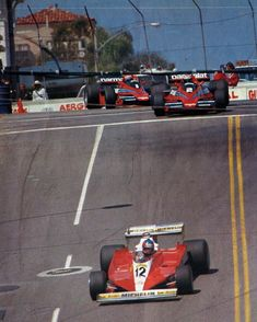 Opening laps of the 1978 Long Beach Grand Prix. Villeneuve leads Watson and Lauda down Linden Ave into turn two.