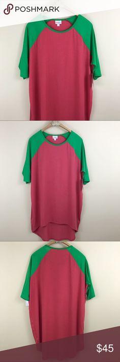 "LulaRoe   NWT Green & Pink Irma Top Brand new LulaRoe Irma tee. Pink and green. Size small. Hi lo hem. Bust: 50"" Length: 32"" LuLaRoe Tops Tees - Short Sleeve"