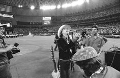 Stevie looks up at the crowd at the Houston Astrodome's 20th anniversary celebration.