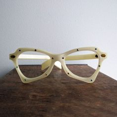 1960s Rhinestone Frames, $28, now @Fab.   Cream pearlescent plastic eyeglass frames with blue, purple, green, and amber rhinestones. This vintage product is in mint, original condition.