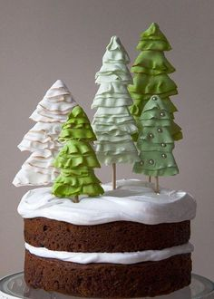 Holiday Winter Wonderland Cake - Style Sweet CA (love the trees!) Frosting on cake is basic meringue frosting Christmas Tree Diy Christmas Sweets, Noel Christmas, Christmas Tree Toppers, Christmas Goodies, Christmas Baking, Winter Christmas, Christmas Cakes, Simple Christmas, Christmas Ideas