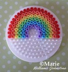 Work an easy perler hama bead rainbow on a circle pegboard
