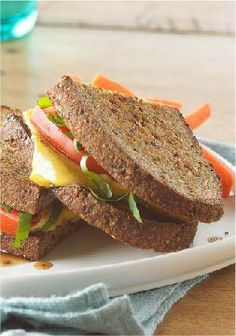 Bruschetta-Style Grilled Cheese Sandwich – Sliced tomato, fresh basil and a drizzle of balsamic vinaigrette five this grilled cheese sandwich its bruschetta style.