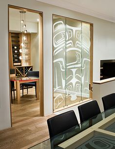 "Wine Room. Glass 'Totems' - Eagle, Whale and Salmon. H 96"" L 77"" D 6"" Hand, sand-carved tempered glass with stainless steel standoffs. Sabina Hill with Mark Preston."