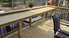 Deck bar with raised edge to prevent placemats and plates from blowing off.