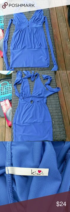 Blue Kiwi halter dress Reposh. Beautiful blue halter dress. Ties behind neck and at back of waist. In great condition but has a little peekaboo cut out in front around bellybutton and I have tiger stripes lol so not really my style. Polyester and spandex. Size medium Kiwi Dresses Midi
