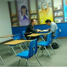 """A brother conducting a bible study at the recently open jw.org """"store"""" in Tijuana, México. Ten days open and they have 19 studies and 200 return visits to do! http://ministryideaz.com"""