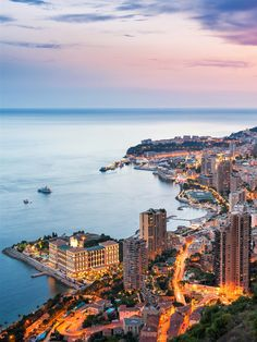 of Monte Carlo, Monaco in Sunset - The MAN Coast of Monte Carlo, Monaco in Sunset Dream Vacations, Vacation Spots, Places Around The World, Around The Worlds, Montecarlo Monaco, Hallstatt, Belle Villa, Beautiful Places To Travel, South Of France