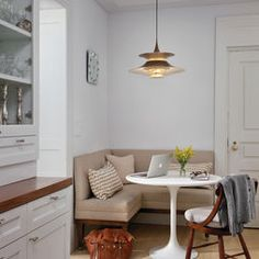 breakfast nook with small table & upholstered banquette