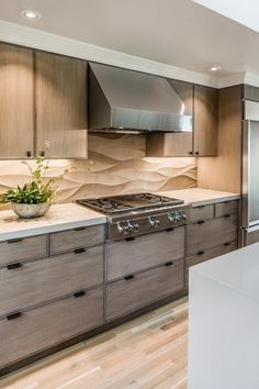 """Contemporary Kitchen with European Cabinets, Subzero - 6"""" built-in over-and-under refrigerator/freezer, Limestone counters"""