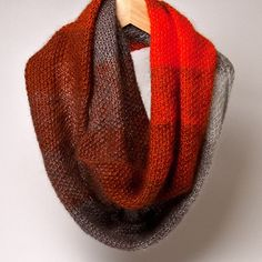 Wrap this dreamy cowl around your neck for warmth and style. 3 strands of luxurious Shibui Knits Silk Cloud held together create this sumptuous circle scarf—a gradient of 4 colors that shift one into