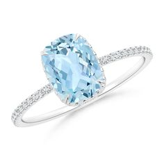 Thin Shank Cushion Cut Aquamarine Ring With Diamond Accents. Beat the morning blues as you let yourself dive in the mesmerizing glare of this delicately handcrafted claw cushion aquamarine and diamond solitaire ring.