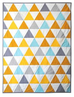 I like the quilting on this. It would look good on the triangle quilt I am currently making.