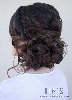 Loose serpentine braids make this updo standout. Hair & Makeup by Steph, Wedding Hairstyles, Hair Updos http://www.colincowieweddings.com/wedding-fashion/10-amazingly-pretty-new-wedding-updos