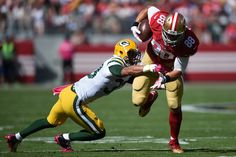 Tight end Garrett Celek #88 of the San Francisco 49ers is hit by strong safety Micah Hyde #33 of the Green Bay Packers during their NFL game at Levi's Stadium on October 4, 2015 in Santa Clara, California. (Oct. 3, 2015 - Source: Thearon W. Henderson/Getty Images North America)