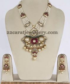 Jewellery Designs: Pearls Set with Dull Finish Jhumkas
