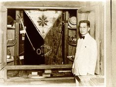 RALLY 'ROUND THE FLAG. Emilio Aguinaldo, then in his 60s, posed postwar in his home in Kawit, Cavite, with his favorite flag, the same flag which is now in the museum set up by his great-grandson in Baguio City. Found tucked under his deathbed, this flag will have to undergo thorough testing, according to historian Ambeth Ocampo, before it can be authenticated as the original one sewn by Marcela Agoncillo in Hong Kong according to the specs of Aguinaldo.