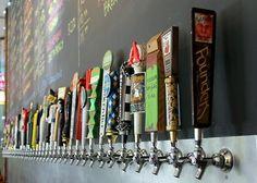 "Row of beer taps www.LiquorList.com  ""The Marketplace for Adults with Taste""  @LiquorListcom   #LiquorList"