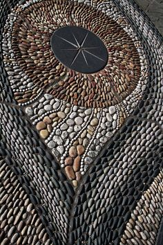 Mosaic floor detail at Nottingham Castle Cafe terrace, UK. By Maggy Howarth.