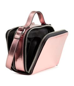 Pink metallic. Small shoulder bag in shimmery, metallic faux leather. Narrow adjustable shoulder strap and handle at top. Two compartments with zip. Lined.