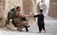 Thirsty? Though it looks like the little Afghan boy is handing the bottle of water to soldier, it's vice versa. A member of Royal Air Force Regiment with his SA 80 rifle, is handing his bottle of water to the Afghan boy. A rare moment not often photographed and shared. via gunrunnerhell @tumblr