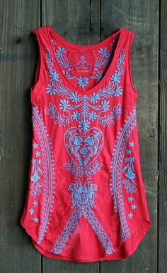 Beautifully embroidered in ocean blue on a rich marischino red shirt tail tank tunic.(http://www.acowgirlspromise.com/johnny-was-shirt-tail-embroidered-tank-tunic-marischino-red-blue/):