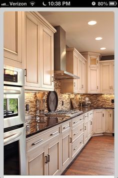 Neutral tile backsplash, dark countertops, light cabinets. Might consider this color scheme for my kitchen.