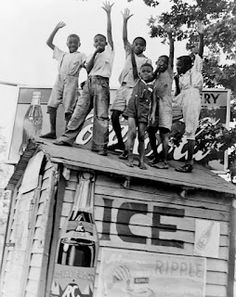 Boys playing on top of Coca Cola stand, Little Rock, Arkansas, 1938, Dorothea Lange photo